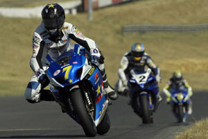 Mladin chased by Ben Bostrom and Tommy Hayden at Infineon